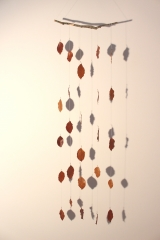 <h5>Copper Beech</h5><p>Fallen Copper Beech leaves, local beeswax, embriodery thread and a stick my toddler brought home from a walk. This piece was exhibited at Falmouth Art Gallery in March 2017.</p>